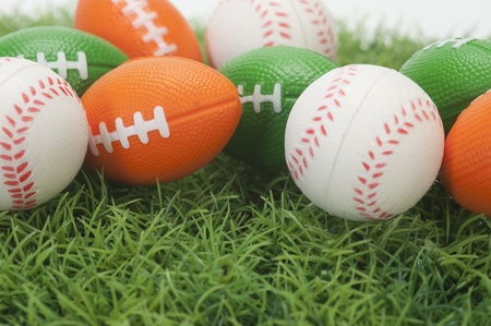 Close-up of assorted balls on grass photo