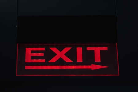 western script: Close-up of an Exit sign