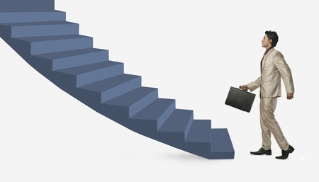 Businessman moving up staircase photo