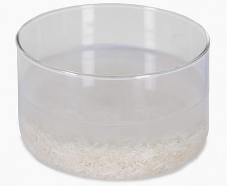 Rice being soaked in a bowl photo