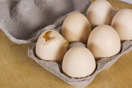 gurgaon: Broken egg in a carton with other eggs