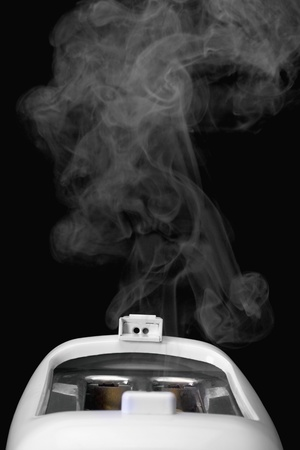 Close-up of a toaster releasing smoke