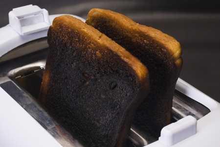 burnt toast: Close-up of burnt toasts in a toaster Stock Photo