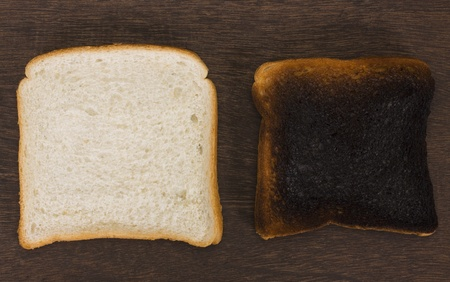 burnt toast: Slice of a bread with a burnt toast