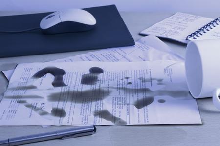 gurgaon: Spilt coffee over documents on a desk