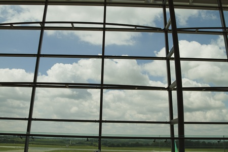 airport lounge: Clouds viewed through an airport lounge window, Cork Airport, Cork, County Cork, Republic of Ireland Stock Photo
