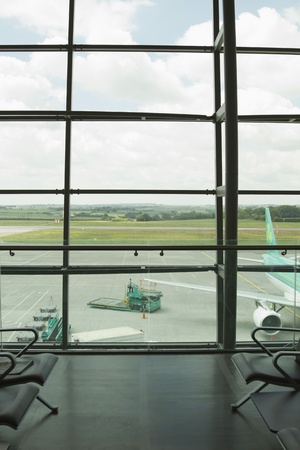airport lounge: Airplane viewed through an airport lounge window, Cork Airport, Cork, County Cork, Republic of Ireland Stock Photo