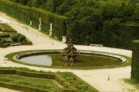 versailles: Fountain in a formal garden, Chateau de Versailles, Versailles, Paris, France