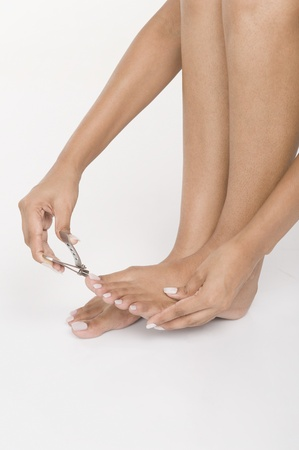 Woman clipping her toenails photo