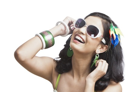 only adult: Beautiful young woman posing with sunglasses Stock Photo