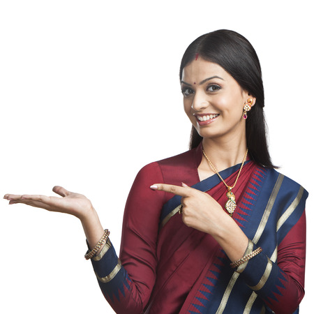 only one young adult woman: Traditionally Indian woman gesturing Stock Photo