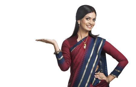 traditionally indian: Traditionally Indian woman gesturing Stock Photo