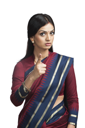 Traditionally Indian woman pointing photo