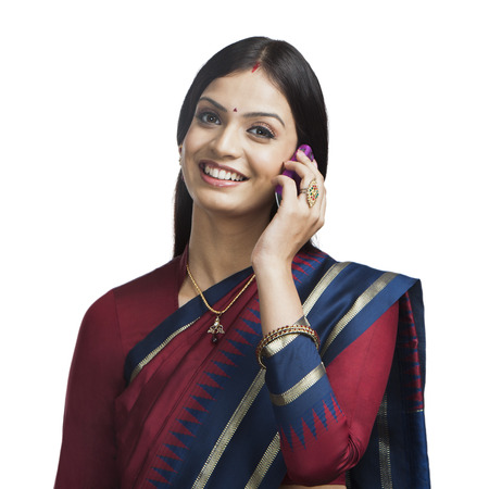 traditionally: Traditionally Indian woman talking on a cell phone Stock Photo