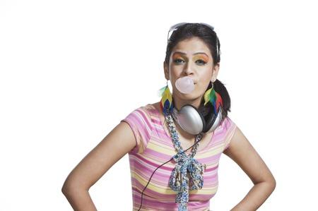 gum: Beautiful young woman blowing bubble gum