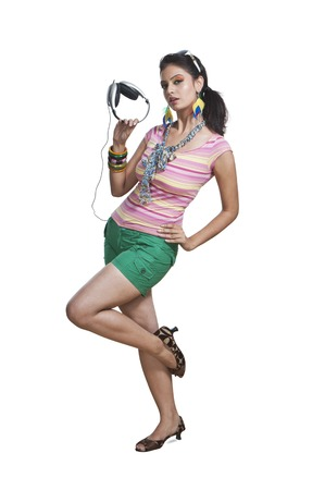 Beautiful young woman posing with headphones photo