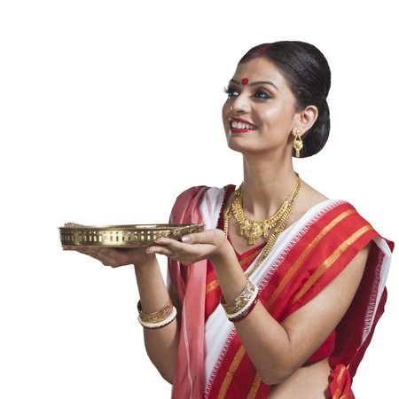 pooja: Traditional Bengali woman holding pooja thali Stock Photo