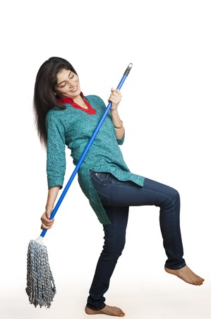 Woman cleaning floor with a mop photo