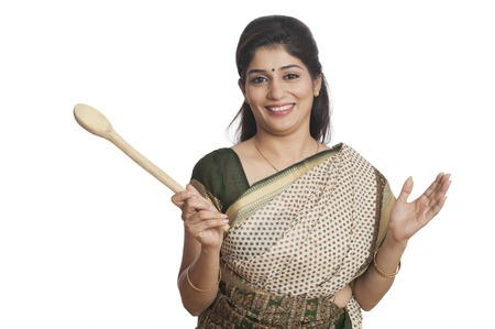 indian women: Portrait of a woman holding Wooden ladle Stock Photo