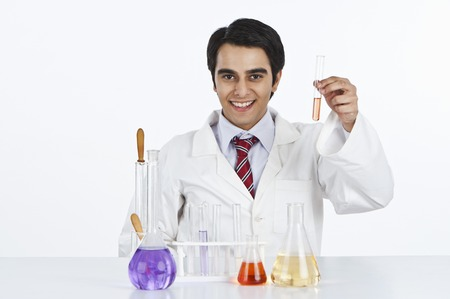 Male scientist working in a laboratory and smiling photo