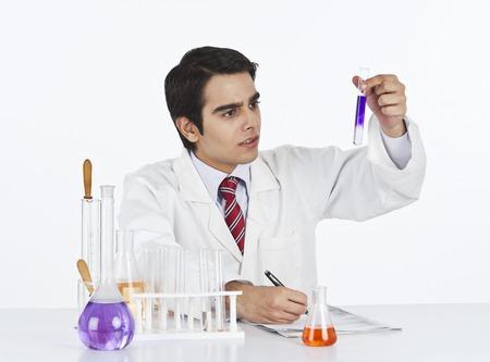 Male scientist doing scientific experiment in a laboratory photo