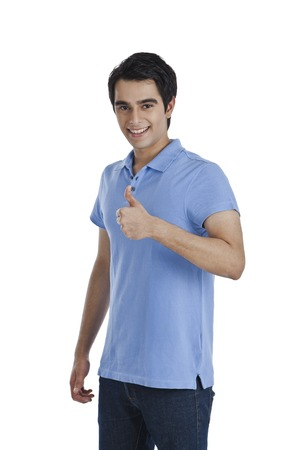 Portrait of a man showing thumbs up sign and smiling