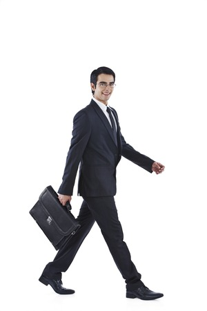 Businessman walking with holding a bag photo