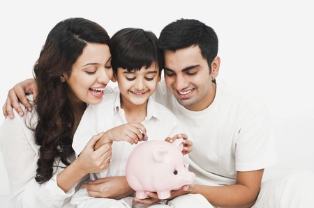 Happy family with a piggy bank photo