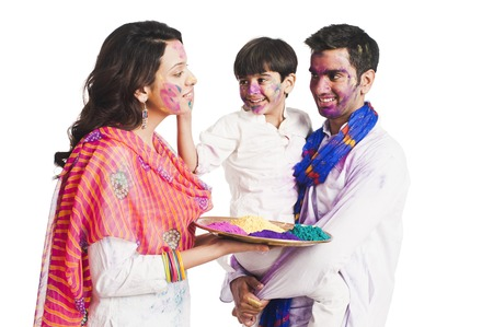 Family celebrating Holi festival photo