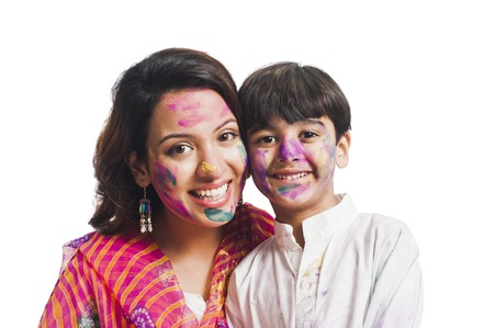 Portrait of a woman with her son celebrating Holi festival photo
