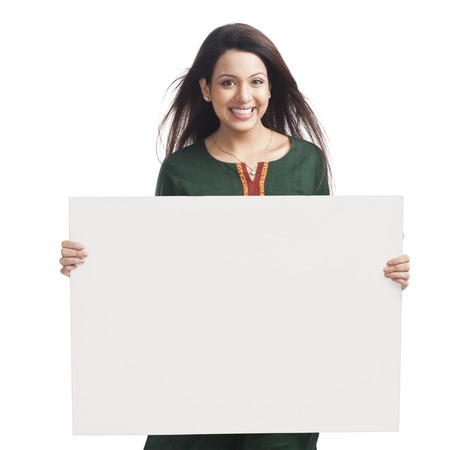 salwar: Portrait of a happy woman holding a whiteboard