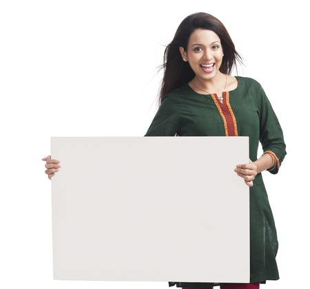 Portrait of a happy woman holding a whiteboard