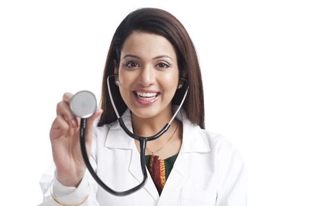 Portrait of a female doctor showing a stethoscope photo