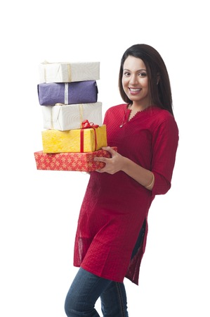 kameez: Portrait of a happy woman holding a stack of gifts