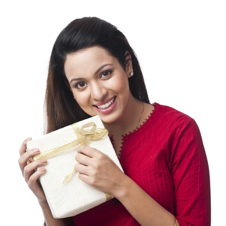 Portrait of a happy woman holding a gift box Stock Photo