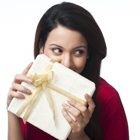 kameez: Close-up of a happy woman holding a gift box