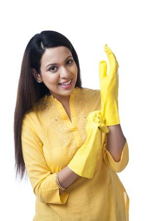 Portrait of a happy woman wearing gloves photo