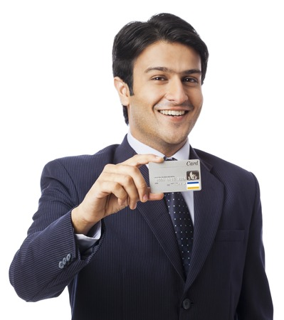 Portrait of a businessman showing a credit card photo