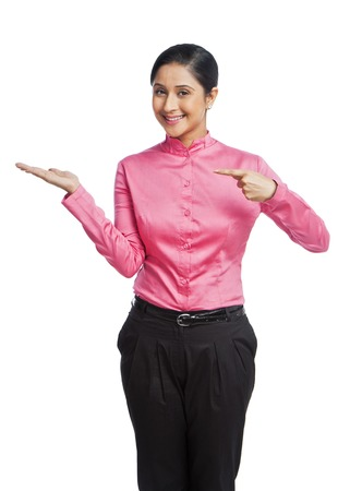 Portrait of a businesswoman gesturing and smiling photo