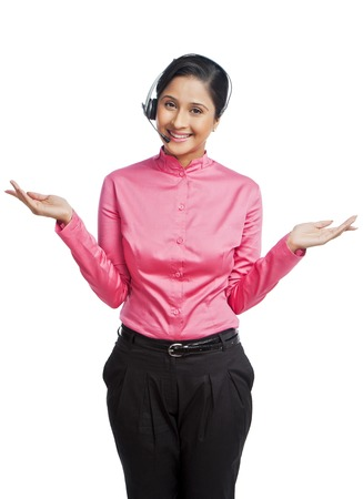 Portrait of a female customer service representative gesturing photo