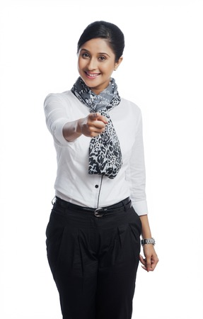 Portrait of a businesswoman pointing and smiling photo
