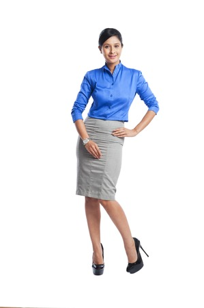 Portrait of a businesswoman smiling with her hand on hip photo