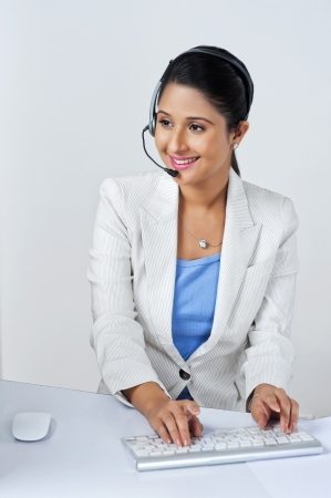 Female customer service representative using a computer photo