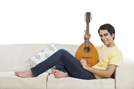 mandolin: Portrait of a man playing a mandolin Stock Photo