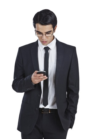 clipping  messaging: Businessman text messaging on a mobile phone Stock Photo