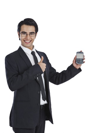 Businessman showing a mobile phone photo
