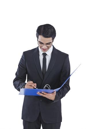 Businessman examining documents photo