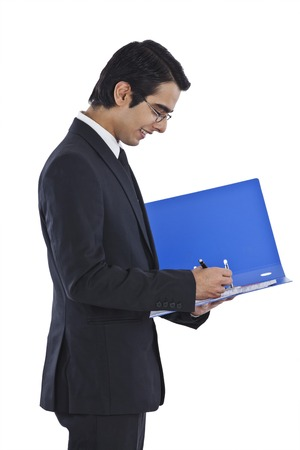 Businessman examining documents and smiling photo