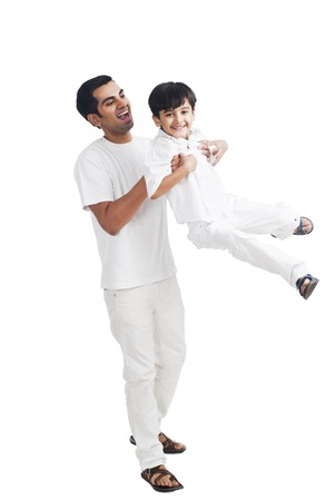 Happy father playing with his son photo