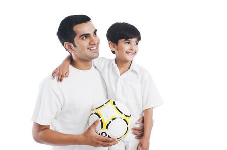 sports clothing: Happy father and son with football